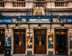 Royal splendour (Мaistora) Tags: theatre building architecture historic royal classic london westminster haymarket history traditon drama opera musical performance acting rada posters displays lighting decoration ornaments splendour queen king majesty monarch hermajestystheatre westend england britain uk leica dlux typ109 lightroom color colour colourful grading brass gold lamp sign signage emblem coatofarms regalia lut