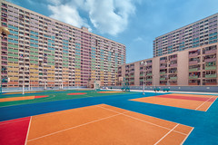 Court Side (Peter Stewart Photography) Tags: choihung rainbow housing estate kowloon hongkong daylight colorful architecture basketball court nopeople stacked shapes lines blue sky