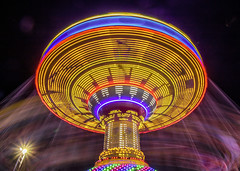 One more from the fair....  Explore (Kevin Povenz Thanks for all the views and comments) Tags: 2010 august kevinpovenz westmichigan michigan ottawa ottawacounty hudsonville hudsonvillefair outside outddors longexposure canon7dmarkii sigma lights movelment spin yellow blue night fair carnival