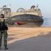 A Sailor directs Landing Craft, Air Cushion as it departs a beach in Jordan.