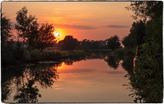 Evening by the canal (Peter Leigh50) Tags: canal countryside cloud sky sun sunset evening towpath grand union water reflection reflections trees fujifilm fuji field farmland boat rural leicestershire xt2