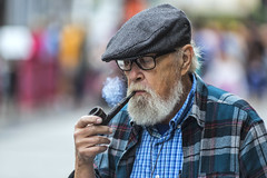 Pipe smoker: a rare sight (Frank Fullard) Tags: frankfullard fullard candid street portrait smoker color colour cap smoke rare unusual galway irish ireland beard pipe puffing check shirt