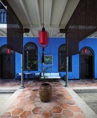 The Blue Mansion (peterphotographic) Tags: p7250571edwm thebluemansion olympus em5mk2 microfourthirds mft ©peterhall penang malaysia seasia asia blue building light window door architecture cheongfatttzemansion georgetown unesco red chinese floor tiles plant planter pot tree fern fengshui