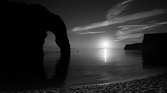 Bw sunset (paullangton) Tags: durdle door bw blackandwhite mono coast jurassic headland arch water sea paddleboarder calm peaceful landscape sun sunset sky clouds 5dmk111 beach silhouette portland heritage reflections