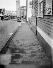 Norman Street, c. 1925 (Salem State Archives) Tags: scph02042 salemmassachusetts normanstreet salemdepot bostonandmaine railroad cocacola moxie cars buildings architecture street georgeabbott