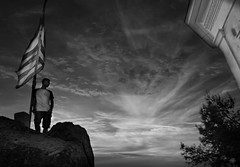 this is Greece (Love me tender ♪¸.•*´¨´¨*•.♪¸.•*´) Tags: greece rocks flags silhouettes boy highkey lookup lookaway sunset poros island saronic dimitrakirgiannaki photography flickr nikond3100 blackandwhite