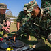 U.S., Timor-Leste service members disassemble an F3 Minelab during Exercise Hari'i Hamutuk