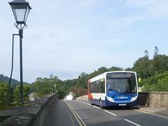 Stagecoach East Scotland 27125 crosses the Telford bridge at Dunkeld. (calderwoodroy) Tags: scotland rivertay perthshire dunkeld tayside perthkinross bridge stonebridge dunkeldbridge bus stagecoach singledecker stagecoacheastscotland service23 27125 sl14lto adl alexanderdennis enviro300