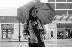 City Girl (sonia balani) Tags: umbrella friend rain rainyday rainy cloudy clouds shopping mall shoppingmall street road wetroad jeans jeanjacket blackandwhite bw hoodie toronto downtowntoronto humansoftoronto canada ontario raindrops springtime spring citygirl bigcity straightface opendoor canon dslr