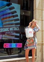 Tired Shopper - Malaga, Spain (TravelsWithDan) Tags: youngwoman blond dress shopping purse shoppingbag ad storewindow outdoors city urban malaga spain europe tired candid streetportrait canong3x