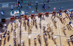 A Half Second In Time (Wes Iversen) Tags: chicago illinois nikkor18300mm bicycles bikes brick children flowerboxes flowers men motion motionblur patterns people police policecars shadows streets walking women dogs