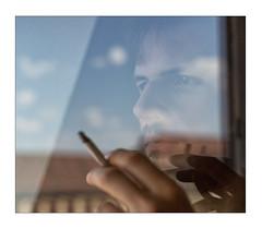 portrait through a window (Armin Fuchs) Tags: arminfuchs thomaslistl jazzinbaggies lavillelaplusdangereuse naturallayer reflection sky blue clouds würzburg diagonal cigarette hand face 6x7 jazz niftyfifty blues bluez eyes