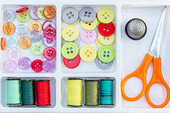 Colorful buttons, thread with scissors and thimble in a sewing box (wuestenigel) Tags: color textile needlework thimble collection background embroidery reel macro bobbin hobby yellow group thread sew tailor cord roll colorful red scissors blue buttons cotton spool bright craft leisure silk object green sewing concept material detail nähen yarn garn schere handarbeit artsandcrafts kunstundhandwerk spule fashion mode noperson keineperson kunst stickerei dressmaker schneider needle nadel textil kind nett buttonplant knopfpflanze baumwolle creativity kreativität motley bunt handmade handgemacht