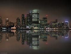 Impresiones de un skyline bajo la niebla (ricardocarmonafdez) Tags: cityscape ciudad city nightshot mirror espejo reflections reflejos color edificios rascacielos skyscraper buildings nocturna nocturnal simetría symmetry fantasy niebla fog mist mood atmosphere atmósfera