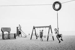 Sometimes life is like a domino effect (karolinabat) Tags: beach blackandwhite summer zipline family playground