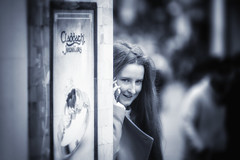 Claddagh Girl (Frank Fullard) Tags: frankfullard fullard candid street portrait claddagh galway irish ireland mobile phone smile smiling happy black white blanc noir monochrome claddaghring love loyalty friendship