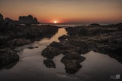 Puesta de sol de la Gueirua (JoseQ.) Tags: puestadesol rocas mar cielo agua colores asturias lagueirua cudillero españa naranja sunset nubes sky sun