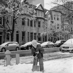 (patrickjoust) Tags: rolleiflex automat mxevs kodak verichrome pan expired 2004 developed rodinal 150 tlr twin lens reflex 120 6x6 medium format black white bw home develop discontinued film blancetnoir blancoynegro schwarzundweiss manual focus analog mechanical patrick joust patrickjoust spring snow llewelyn kid boy child playing shovel portrait row house apartment building baltimore maryland md