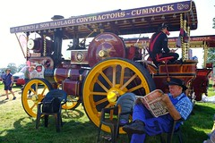 Taking a break (benpadley) Tags: steam shrewsburysteamrally newspapers steamengine wheels shrewsbury colour candid