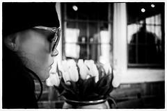 The motionless lady (Loek van Straaten) Tags: potsdam germany street streetphotography candid city peoplelady woman mannequin glasses cap flowers window reflection blackandwhite black white bw monochrome loek vanstraaten