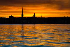 Stockholm sunset (snowyturner) Tags: stockholm sweden spires churches sunset landscape sky golden reflections water ripples