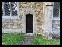 Tiny Door. St Edmund's Church. Egleton. Rutland (M E For Bees (Was Margaret Edge The Bee Girl)) Tags: stedmunds church rutland churchofengland anglican norman old outdoors door stone wall windows leaded walkingstick black small
