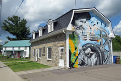 La Maison du patrimoine (circa 1820) in the municipality of Grenville, Quebec (Ullysses) Tags: maisondupatrimoine grenville quebec canada grenvillecanal warof1812 canal grenvillelodgeno101 grenvillemasoniclodgeno101 summerété heritageproperty mural murale canadianhistory