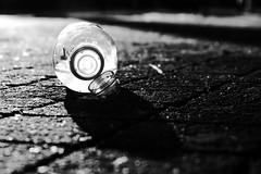 Street (lightersideofdark) Tags: streetphotography street dark outside outdoors cobbles blockpaving bottle shadows shadow art blackwhite blackwhiteart artofblackwhite creativephotography darklight