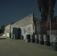 Off Mission Road (ADMurr) Tags: la eastside mission road barrel wall hasselblad 500cm 50mm zeiss distagon dad706 fuji pro 400 6x6 film square