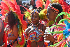 DSC_7475 Notting Hill Caribbean Carnival London Mas Players Parade Participant Performer Exotic Colourful Orange Showgirl Costume with Ostrich Feather Wings August 26 2019 Beautiful Stunning Girl Décolleté Low Neckline Beautiful Breasts Cleavage (photographer695) Tags: notting hill caribbean carnival london mas players parade participant performer exotic colourful showgirl costume with ostrich feather wings august 26 2019 beautiful stunning girls orange girl décolleté low neckline breasts cleavage