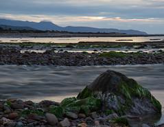 Seascape (ivanstevensphotography) Tags: sea seaside water seaweed rocks pebbles sand sunset river light clouds mountains seascape canonphotography canon80d canonuk landscape nature