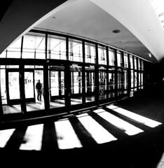Front Entrance Place Des Arts (Montreal) (MassiveKontent) Tags: city bw geometric lines architecture contrast montreal placedesarts bwphotography streetshot urban blackandwhite canada blancoynegro glass monochrome silhouette metal photography mono lightsandshadows noir doors shadows montréal noiretblanc quebec entrance symmetry absoluteblackandwhite