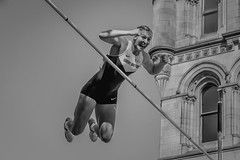 Winner! (FireDevilPhoto) Tags: sport women oneperson outdoors females exercising people action athlete youngadult sportsclothing blackandwhite caucasianethnicity blackcolor urbanscene jumping muscularbuild manchester polevault mono bw nikon d500 celebration