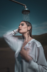 Fountain of Youth (Camille Marotte) Tags: water shower iceland 2019 leicaq2 leica portrait sky people woman wet fountain girl beauty face fashion clouds hair landscape gold landscapes necklace model editorial jewels luxury oneperson earing