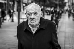 Watching You (Leanne Boulton) Tags: urban street candid portrait portraiture streetphotography candidstreetphotography candidportrait streetportrait eyecontact candideyecontact streetlife old man male face eyes expression mood emotion feeling eye tone texture detail depthoffield bokeh naturallight outdoor light shade city scene human life living humanity society culture lifestyle people canon canon5dmkiii 70mm ef2470mmf28liiusm black white blackwhite bw mono blackandwhite monochrome glasgow scotland uk