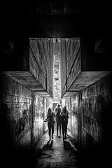 Castelgrande, Bellinzona - Switzerland (Patrik S.) Tags: switzerland castle tessin ticino bw blackandwthite sony a7m3 a7iii entry dark light girls people back entryway entrance history historic white black concrete ngc