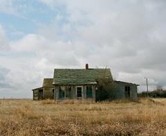 Mamiya RB67 / Kodak Portra 160. (Fistfulofpowder) Tags: saskatchewan ghost town abandoned mamiya rb67 medium format film 120mm kodak portra 160 sky clouds grass field house decay