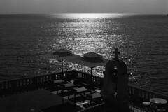 Adriatic Dreams  (Tri-X 400) (Harald Philipp) Tags: adriatic sea montenegro svetistefan amanhotel coastal church tables lounger deck patio nikon fm3a trix iso400 film analog travel tourist