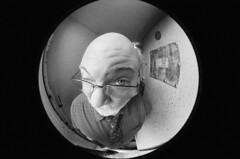 Fisheye meets Pete's eye (Zeb Andrews) Tags: nikonf3 ilforddelta3200 onceinabluemoon coworker fisheye nikkor8mmf28 pete blackwhite 35mm portland oregon bluemooncamera 24x36mm distorted