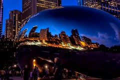 The Bean At Blue Hour (Wes Iversen) Tags: chicago chicagoloop clichesaturday cloudgate hcs illinois loop michiganavenue millenniumpark nikkor18300mm thebean bean bluehour children men people reflections sculpture skyscrapers stainlesssteel women