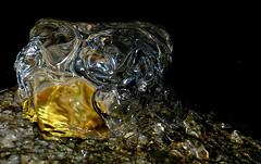 water in motion (HansHolt) Tags: bubblingrock borrelsteen pond vijver water nacht night reflection fountain bubbles gold light stone rock steen sparkling glittering macro olympusmju9010 olympusstylus9010 smileonsaturday letitflow