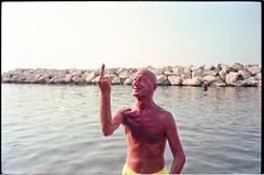 (In Hoc Signo) (Robbie McIntosh) Tags: leicamp leica mp rangefinder streetphotography 35mm film pellicola analog analogue negative leicam elmarit analogico leicaelmarit28mmf28iii elmarit28mmf28iii dyi selfdeveloped filmisnotdead autaut candid bellinifotoc41 kodakportra160 kodakportra portra kodak beach tan seaside bathers strangers swimsuit man summer summertime speedo portrait pose