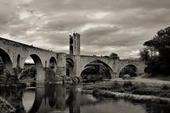 Besalú (montseny visions) Tags: catalunya catalonia landscape besalú garrotxa historic ciel village sky light clouds bw old ngysa ngysaex