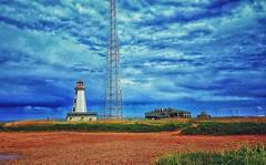 North Cape (Book'em) Tags: northcape pei princeedwardisland canada lighthouse ocean atlantic clouds snapseed hss seacowpond tignish
