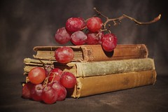 Still Life (DayBreak.Images) Tags: tabletop stilllife antique vintage books grapes canondslr meyeroptic 50mm trioplan genaraytorpedo photoscape texture