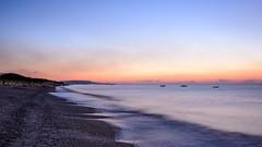 sunrise by the sea (freemanphoto) Tags: sea mare spiaggia calabria italia reggio beach sunrise alba bluehour ora blue orange riviera gelsomini sand stones sabbia sky cielo landscape sunshine