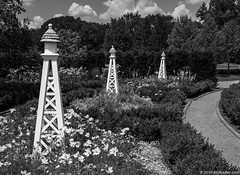 Garden Lighthouses (Jim Frazier) Tags: botanic botanicgardens botanical botanicalgardens buroakgarden bw cantigny cantignypark class décor decorations desaturated diagonals doneexportedtoflickr dupage dupagecounty echo echoing flora floral flowering flowers formalgardens garden gardenartifacts gardening gardens highcontrast horticulture il illinois jimfraziercom july landscape leadinglines loadcode201908 middaylight minimalism monochrome museums nature outdoor parks patterns photowalk plants points preserves publicgardens q4 ruleofodds ruleofthirds scenery scenic sculpture simplicity sizeover1000 statuary statues summer sunny triangles upperburoakgarden upperterrace verticals wheaton whimsicalgardenstatuary f10
