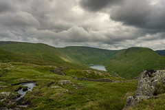lake view (Tobias Hahn) Tags: water lake fells hills mountain landscape grass fields cloudy clouds wood trees rock england uk district summer