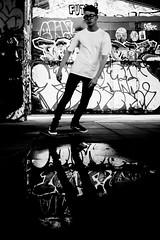 And Turn (Sean Batten) Tags: london england unitedkingdom southbank skateboard blackandwhite bw streetphotography street city urban fujifilm x100f person candid puddle reflection graffiti