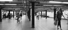 Underground, New York (jev) Tags: 135w 24x54mm 40mm 45mm bronicaetrs zenzabronicaetrsi zenzanon analog analogcamera artq back blackandwhite bnwphotography buyfilmnotmegapixels bwmaniac family film filmcamera filmfeed filmphotography filmphotographyishootfilm ishootfilm istillshootfilm mediumformat monochrome newyork nyc nyphotographer panoramic peopleinframe peoplewatching streetlife streetphoto streetphotography streetshots streetstyle underground unionsquare vintagecamera wide xpan